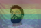 Young african american man superimposed over rainbow flag and code screen
