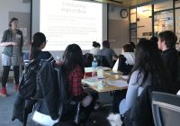 Women instructing class, on screen: Combating Implicit Bias
