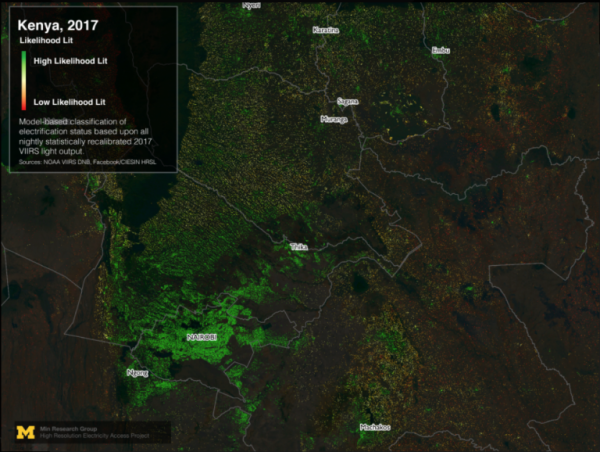 An aerial view of Kenya at night, with concentrations of green dots that display areas that are electrified.