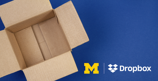 an open cardboard as viewed from above, with the block M logo and the dropbox logo