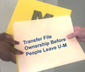 A file folder is handed from one person to another.